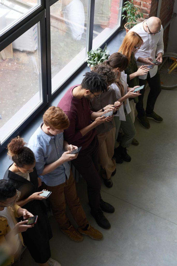 teenagers looking at phones