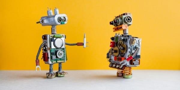 Two Twitter bots on a light orange backgrop